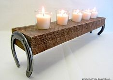Horseshoe and repurposed wood...there is  more to this than just a candle holder....