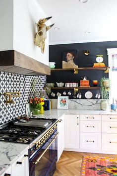 Eclectic Home Tour - love this white kitchen with black walls, open shelves and blue stove Eclectic Kitchen, Eclectic Decor, New Kitchen, Eclectic Style, Eclectic Design, Boho Kitchen, Awesome Kitchen, Vintage Kitchen, Kitchen Ideas