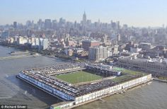 NY Soccer: The soccer field on New York's Hudson River, tilt-shifted, with a mini Manhattan in the distance