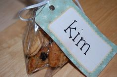 tags like this can be found at Michael's and a way to personalize party treat bags for each guest