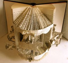 """Great idea for recycling an old book. I used to make """"christmas trees"""" out of TV guides by doing something similar...fun!"""