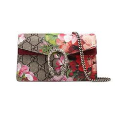 Shop the Dionysus Blooms print mini chain bag by Gucci. A structured Blooms print leather chain mini bag or wallet with our textured tiger head spur closure-a unique detail referencing the Greek god Dionysus, who in myth is said to have crossed the river Tigris on a tiger sent to him by Zeus. The GG Blooms print was first presented throughout the Fall/Winter 2015 Fashion Show collection and has continued to evolve as an iconic Gucci print.