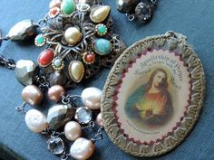 Antique Assemblage Necklace Sacred Heart  Scapular Pearls Pyrite Sterling Silver by WhatOnceWas on Etsy https://www.etsy.com/listing/203640890/antique-assemblage-necklace-sacred-heart