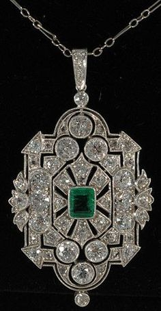 An Art Deco pendant set in platinum with emeralds and diamonds. #ArtDeco #pendant #beautifuljewelrydiamonds