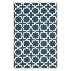 """Anchor your living room seating group or master suite ensemble in luxe style with this hand-tufted wool rug, showcasing an eye-catching quatrefoil trellis motif in navy blue and ivory.   Product: RugConstruction Material: WoolColor: Navy blue and ivoryFeatures:  Hand-tuftedQuatrefoil trellis motifMade in India Pile Height: 0.63""""Note: Please be aware that actual colors may vary from those shown on your screen. Accent rugs may also not show the entire pattern that the corresponding area rugs…"""