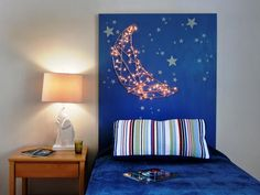 "Only problem with this is the idea that it's for a ""little boy's bedroom"". I'm sorry, I can't think of a little girl who wouldn't think this was awesome too!  15 Easy-to-Make DIY Headboard Projects: Holiday lights are used to create a built-in night-light in a little boys bedroom. Glow-in-the-dark stars accompany the moonlight for some extra sparkle. From DIYnetwork.com"