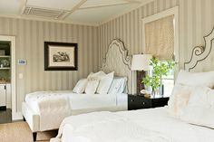 Refined Guest Suite - Gracious Guest Bedrooms - Southernliving. With its tone-on-tone striped wallpaper and dark wood finishes, this elegant bedroom has a distinctly masculine feel.