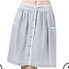 Vintage inspired skirt NWOT Brand new Vintage inspired gray skirt with white trim details. Button up front with pockets on front. Pair with heels,a classy top and statement jewelry.  A-line cut Size small  PRICE IS FIRM NO TRADES Skirts