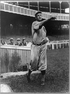 Orval Overall, baseball player for Chicago Cubs, throwing baseball in front of grandstand