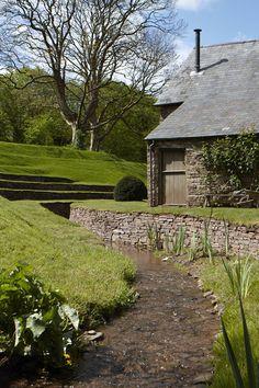 stone sided stream and terraced hill --Journal, Arne Maynard Garden Design