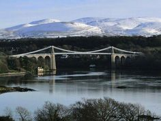 The Menai Suspension Bridge, between North Wales and the Isle of Anglesey. Snowdonia provides a beautiful backdrop.