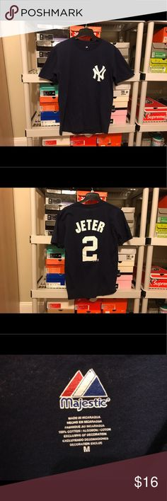 Vintage New York Yankee Derek Jeter #2 shirt sz M Vintage Majestic New York Yankee Derek Jeter Number 2 Ten Logo Navy Blue T Shirt   Size Medium (refer to measurements)    Good condition!   Pit To Pit: 19.5 inches   Neck To Bottom: 27.5 inches   All measurements are taking with items laying flat!   If you have any questions please message me thanks!    Check out my other listings! Majestic Shirts Tees - Short Sleeve