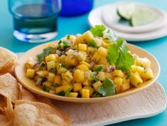 Don't be fooled by this innocent-looking fruit salsa. A minced hot pepper cuts the sweet mango and pineapple chunks.