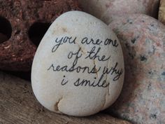Simple, elegant words of inspiration hand written on authentic white Lake Erie beach stone.