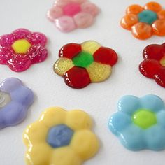 DIY melted bead flowers. Fun and easy!  fridge magnets? (These are adorable!)