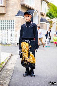 "Yoshito on the street in Harajuku wearing a cropped top by the South Korean streetwear brand More Than Dope with a vintage skirt/hakama (he described it as ""hakama"") over pants and black lace up boots. Full Look Asian Street Style, Tokyo Street Style, Japanese Street Fashion, Tokyo Fashion, Harajuku Fashion, Korean Fashion, India Fashion, Street Styles, Quirky Fashion"