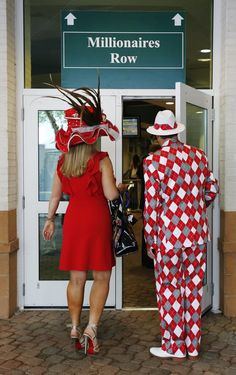 Spectators make their way to the grand stand viewing area before the 138th Kentucky Derby horse race at Churchill Downs Saturday, May 5, 2012, in Louisville, Ky.