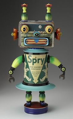 weskit: Robot sculpture made from re-purposed materials- space lunch box, vintage tin, wrenches, painted wooden pieces. Created by Mark Bro...