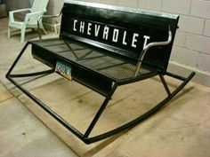 Outdoor rocking bench made from an oldtailgate.