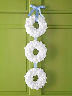 This is a white pom pom christmas wreath but I'm thinking cotton balls (much cheaper) and then a light coating of fake snow spray.