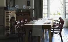 Dark olive paneled wainscoting goes great with the brick in this dining room Space Architecture, Old World Charm, Hurley, Beautiful Homes, Family Room, Dining Table, Dining Rooms, Sweet Home, Room Decor