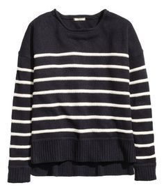 Sweater in striped, cotton-blend knit fabric with a rolled edge at neckline. Dropped shoulders, long sleeves, ribbing at cuffs and hem, and slits at sides. Slightly longer at back. Black & white striped. | Warm in H&M