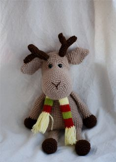 gray reindeer- an amigurumi christmas stuffed animal with striped scarf OOAk unique.  $44  http://www.etsy.com/listing/87097562/gray-reindeer-an-amigurumi-christmas?ref=sr_gallery_25&ga_search_submit=&ga_search_query=Amigurumi+crocheted+stuffed+animals&ga_view_type=gallery&ga_ship_to=US&ga_page=2&ga_search_type=handmade&ga_facet=handmade