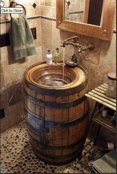 Old barrel  stylish and functional sink! I love the rustic look and earth tones of this room.