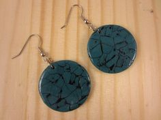 These handmade polymer clay disk earrings were crafted from shimmering turquoise polymer clay and black acrylic paint to resemble stone. They are coated in water-based varnish to provide a polished look, but also feature a cracked texture.