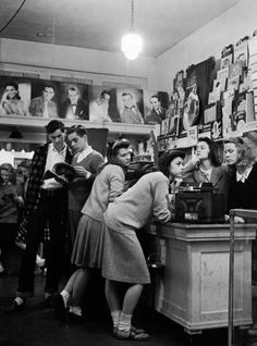 Group of teenagers listening to 45 rpm. records as they shop for the latest hits at a record store, photo by Nina Leen, 1944. Bobby sox times