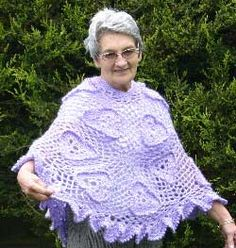 Irish Trefoil Poncho.  A lacy poncho in an Irish Crochet Style.  Irish Lace is traditionally worked in fine thread with a very small hook.  This beautiful craft was originally developed in 19th century Ireland as a method of imitating expensive Venetian point laces.  This Poncho is worked using yarn and a larger hook.  The motifs used, although based on traditional patterns, have been altered to accommodate today's style of crochet.