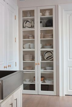 I am going to rip out the built in desk area in my kitchen and copy this glass door/shelf idea!