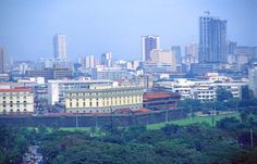 Manila skyline with Rizal Park and Intramuros