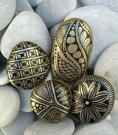 Gold paint pen on black rocks; This could work! Gold paint pen on black rocks; This could work! Stone Art Painting, Dot Art Painting, Rock Painting Designs, Pebble Painting, Pebble Art, Mandala Painted Rocks, Mandala Rocks, Hand Painted Rocks, Painted Stones