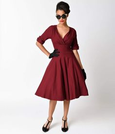 Let Delores get domestic with you, darling. A bewitching burgundy dress rich in 1950s vintage appeal fresh from Unique Vintage, Delores is unparalleled! Boasting a gathered surplice v-neckline, trim and tailored half sleeves with darling button detail and