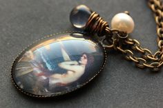 Mermaid Necklace. Mermaid Pendant with Dark Blue Teardrop and Fresh Water Pearl. Oval Charm Necklace. Mermaid Jewelry. Handmade Jewellery. by StumblingOnSainthood from Stumbling On Sainthood. Find it now at http://ift.tt/2iAC1W2!