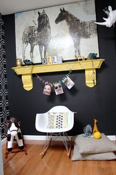 Love the idea of using a reclaimed fireplace mantel as a wall shelf.  And I LOVE graphic baby rooms.
