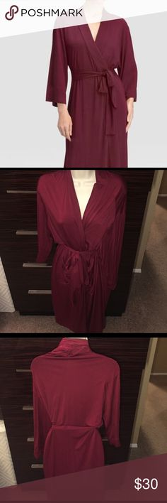 Organic cotten knitted bathrobe sz S/M Slide into this plush knee length knitted cotton bath robe to keep warm after a shower while you prepare for a busy day or after a bath to relax with a book by the fireplace. Pair the robe with slippers to move about the house in comfort. Keep the robe loose or snug to fit your preference with the included belt. Pure Fiber Intimates & Sleepwear Robes