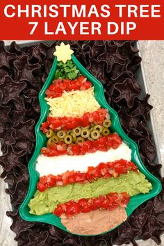 This easy Christmas Tree 7 Layer Dip is sure to make your holiday fiesta even more festive! #appetizer #christmasappetizer