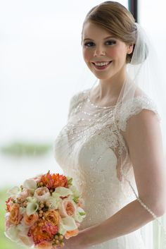 Lindsay & Nick | Wedding in Tampa Bay | Peach, pink and white bridal bouquet. #andrealaynefloraldesign #tampaweddings