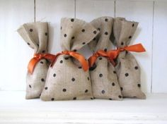 Simple burlap bags with black polka dots (paint and peril eraser) tied up with orange ribbon for Halloween goodies