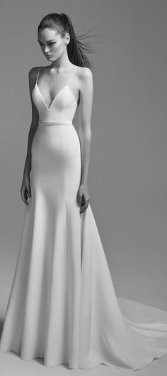 "Satin Trumpet Gown""featuresa fitted silhouette with a low v neckline, spaghetti straps and gathered flare skirt #weddingdress #weddinggown"