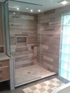 Bianco wood shower, no door, with glass block window and floating vanity