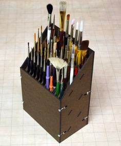 Paint brush rack holds 17 larger brushes and 32 smaller brushes.