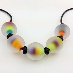 Wow these are such beautiful beads. They have a colourful core encased in clear then etched.