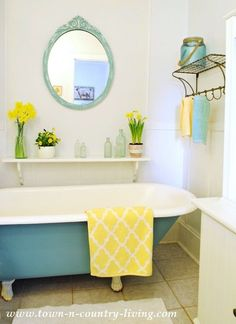 With a can of Annie Sloan Chalk Paint, I changed the look of my farmhouse claw foot tub with a stroke of beautiful Provence Blue!