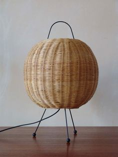 Anonymous; Enameled Metal and Wicker Table Lamp, 1950s.