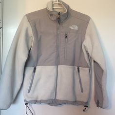 North face White and Grey Denali zip up jacket The North Face Size xs. Greg and White zip up jacket. There is a small dot near the logo on the back, and sleeves are not in perfect condition. Willing to post more pictures or sell cheaper on Ⓜ️ercari North Face Jackets & Coats