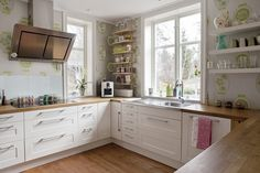 You would never know the cabinets and counter were Ikea with wall paper and open shelves. By Cat Brewis