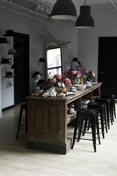 Bohemian Traditional Urban Dining Room: Large pendant lamps hang over a Kentucky Derby themed party .